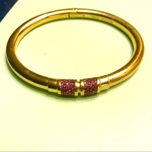 Michael Kors gold bangle with pink sparkle